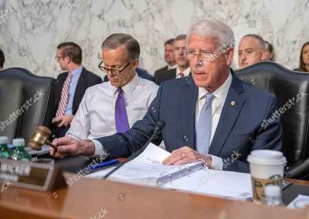 United States Senator Roger Wicker (Republican of Mississippi), Chairman, US Senate Commerce, Science, and Transportation, calls the hearing to order where Dennis Muilenburg, President and Chief Executive Officer, The Boeing Company and John Hamilton, Vice President and Chief Engineer, Boeing Commercial Airplanes, will testify before the committee on 'Aviation safety and the future of Boeing's 737 MAX'. At left is US Senator John Thune (Republican of South Dakota).