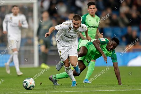 Real Madrid's Eden Hazard, centre, is challenged by Leganes' Kenneth Omeruo during a Spanish La Liga soccer match between Real Madrid and Leganes at the Santiago Bernabeu stadium in Madrid, Spain