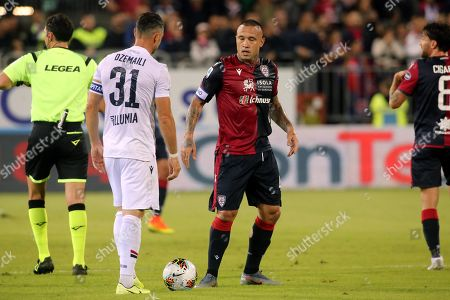 Stock Photo of Cagliari's Radja Nainggolan (R) and Bologna's Blerim Dzemaili in action during the Italian Serie A soccer match Cagliari Calcio vs Bologna FC at Sardegna Arena stadium in Cagliari, Sardinia island, Italy, 30 October 2019