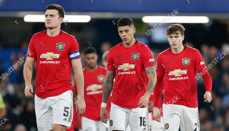 (l-r) Harry Maguire, Marcos Rojo and Victor Lindelof of Manchester United
