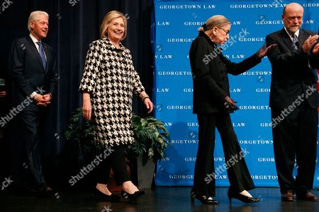Ruth Bader Ginsberg, Bill Clinton, Hillary Clinton, William Treanor. Supreme Court Justice Ruth Bader Ginsberg gestures next to Georgetown Law Dean William Treanor, right, as she arrives to speak along with former President Bill Clinton and former Secretary of State Hillary Clinton, for Georgetown Law's second annual Ruth Bader Ginsburg Lecture, in Washington