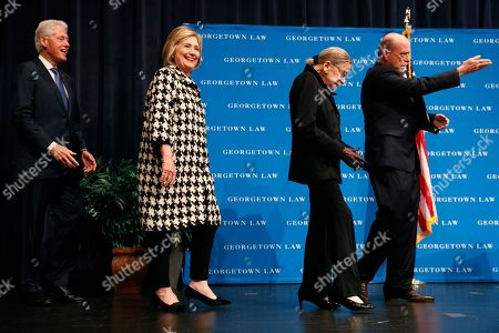 Stock Picture of Ruth Bader Ginsberg, Bill Clinton, Hillary Clinton, William Treanor. Georgetown Law Dean William Treanor, right, gestures to their seats as Supreme Court Justice Ruth Bader Ginsberg arrives to speak along with former Secretary of State Hillary Clinton, and former President Bill Clinton, at Georgetown Law's second annual Ruth Bader Ginsburg Lecture, in Washington