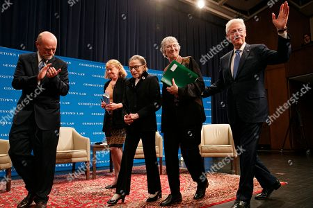 Stock Image of Ruth Bader Ginsberg, Bill Clinton, Hillary Clinton, William Treanor, Mary Hartnett, Wendy Williams. Supreme Court Justice Ruth Bader Ginsberg, center, walks with from left, Georgetown Law Dean William Treanor, law professors and authorized Ginsburg co-biographers Mary Hartnett and Wendy Williams, and former President Bill Clinton, after Georgetown Law's second annual Ruth Bader Ginsburg Lecture, in Washington