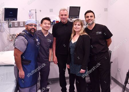 Doctor Parish Vaidya, Doctor Sloane Yu, Joe Montana, CEO and founder of Stimwave Laura Perryman and Doctor James Petros pose at the Trinity Surgery Center, Montana is having a procedure to implant an electroceutical pain relieving device 'Stimwave Freedom Stimulator'