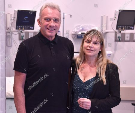 Hall of Fame quarterback Joe Montana and CEO / Founder of Stimwave Laura Perryman pose at the Trinity Surgery Center, Montana is having a procedure to implant an electroceutical pain relieving device 'Stimwave Freedom Stimulator'