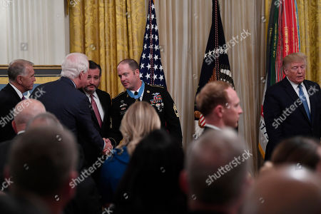 Donald Trump, Matthew Williams, Ted Cruz, John Cornyn, Thom Tillis. U.S. Army Master Sgt. Matthew Williams, fourth from left, currently assigned to the 3rd Special Forces Group, shakes hands with Sen. John Cornyn, R-Texas, second from left, as he is surrounded by Sen. Thom Tillis, R-N.C., left, and Sen. Ted Cruz, R-Texas, third from left, after President Donald Trump presented him with the Medal of Honor during a ceremony in the East Room of the White House in Washington