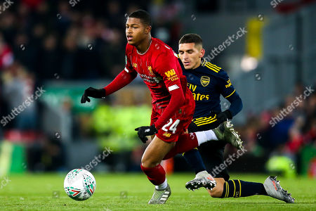 Rhian Brewster of Liverpool takes on Lucas Torreira of Arsenal