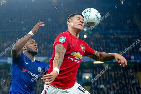 Tammy Abraham of Chelsea and Marcos Rojo of Manchester United compete for the ball in the air