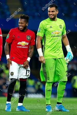 Fred of Manchester United has a joke with Sergio Romero of Manchester United before the game