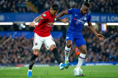 Marcos Rojo of Manchester United and Micjy Batshuayi of Chelsea battle for the ball