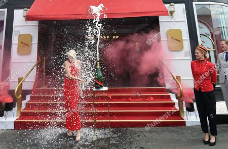 Stock Photo of Australian model and television presenter Kate Peck is showered in champagne outside the Mumm Champagne marquee during a media preview of the Birdcage ahead of the Melbourne Cup Carnival at Flemington Racecourse in Melbourne, Australia, 31 October 2019. The 2019 Melbourne Cup will be held at 11:00am local time on 05 November.