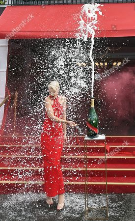 Australian model and television presenter Kate Peck is showered in champagne outside the Mumm Champagne marquee during a media preview of the Birdcage ahead of the Melbourne Cup Carnival at Flemington Racecourse in Melbourne, Australia, 31 October 2019. The 2019 Melbourne Cup will be held at 11:00am local time on 05 November.