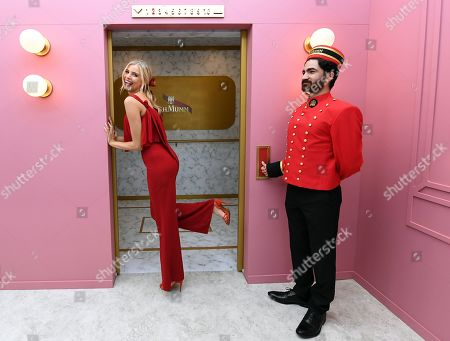 Austrlian model Tegan Martin (L) poses for photos during a media preview of the Birdcage ahead of the Melbourne Cup Carnival at Flemington Racecourse in Melbourne, Australia, 31 October 2019. The 2019 Melbourne Cup will be held at 11:00am local time on 05 November.