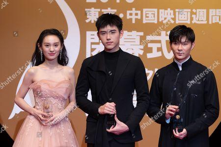 Wang Xi, Chen Feiyu and Wang Jia hold their Gold Crane Award at the China Film Week Closing Ceremony during the Tokyo Film Festival