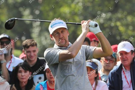 Ian Poulter of England prepares to tee off for the HSBC Champions golf tournament held at the Sheshan International Golf Club in Shanghai on
