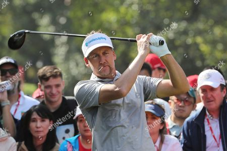 Ian Poulter of England prepares to tee off for the HSBC Champions golf tournament at the Sheshan International Golf Club in Shanghai