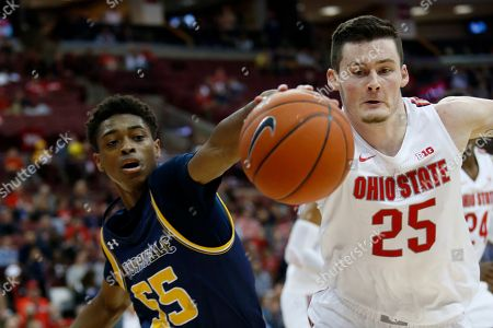 Ohio State forward Kyle Young, right, reaches for a loose ball against Cedarville guard Quinton Green during an NCAA college basketball exhibition game in Columbus, Ohio, . Ohio State won 95-52