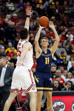 Cedarville forward Jacob Drees, right, goes up for a shot in front of Ohio State forward Kyle Young during an NCAA college basketball exhibition game in Columbus, Ohio, . Ohio State won 95-52