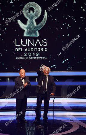 Stock Image of Rafael Inclan (R) receives the 'Una Vida en el Escenario' (a life on stage) award during 'Las Lunas del Auditorio 2019' awards ceremony in Mexico City, Mexico, 30 October 2019.