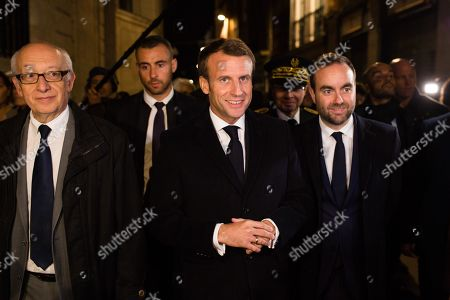 French President Emmanuel Macron, Rouen's mayor Yvon Robert and the prefet of Normandie and Seine Maritime Pierre-Andre Durand and Minister for Local Authorities, attached Minister of Territorial Cohesion and Relations with Local Authorities Sebastien Lecornu walks in the street of Rouen,, in Rouen, during his visit one month after a fire broke out at the Lubrizol chemicals factory. The fire at the Lubrizol plant just outside the French city of Rouen saw some thousands of tonnes of chemical products burned and acrid smoke spread some 22 kilometres (14 miles) from the site.