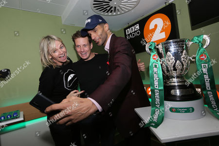 Mike Williams BBC 2 sports presenter , Zoe Ball and David James with the Carabao Cup trophy