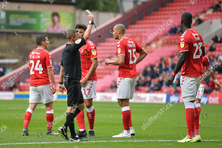 Stock Photo of Mouhamadou-Naby Sarr of Charlton Athletic is shown a yellow card by David Webb match referee