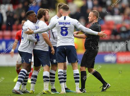 Preston players surround David Webb match referee