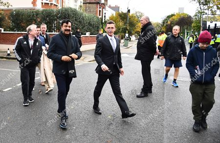 Fulham Chairman and owner Shahid Khan arrives with CEO Alistair Mackintosh