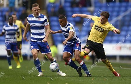 Ben Thompson of Millwall battles with  Andy Rinomhota of Reading