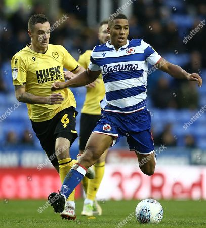 Andy Rinomhota of Reading  and Shaun Williams of Millwall
