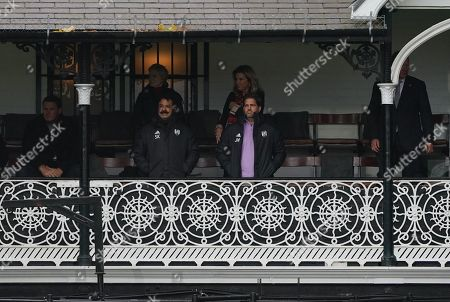 Fulham Chairman and owner Shahid Khan watches the match from the cottage