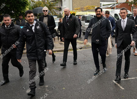 Fulham Chairman and owner Shahid Khan arrives with his son Tony