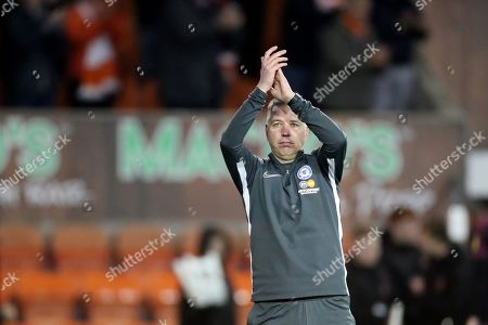 Stock Picture of Peterborough United manager Darren Ferguson applauds fans at the end of the match