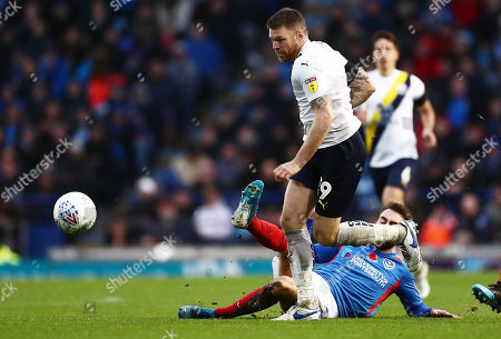 Jamie Mackie of Oxford United is tackled by Ben Close of Portsmouth.
