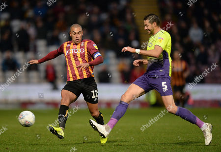 James Vaughan of Bradford City vies for the ball with Aaron Martin of Exeter City