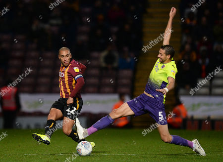 James Vaughan of Bradford City gets the ball past Aaron Martin of Exeter City