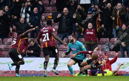 James Vaughan of Bradford City wheels away to celebrate scoring their second goal