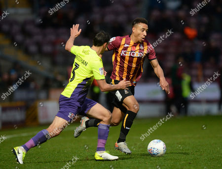 Adam Henley of Bradford City tries to shake off Craig Woodman of Exeter City