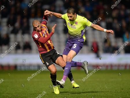 Aaron Martin of Exeter City clatters into James Vaughan of Bradford City