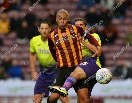 James Vaughan of Bradford City fends off Craig Woodman of Exeter City