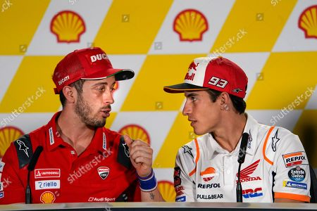 Marc Marquez, Andrea Dovizioso. MotoGP rider Marc Marquez of Spain, right, speaks to Italy's rider Andrea Dovizioso of the Ducati Team during a press conference at Sepang International Circuit ahead of the MotoGP Malaysian Grand Prix in Sepang
