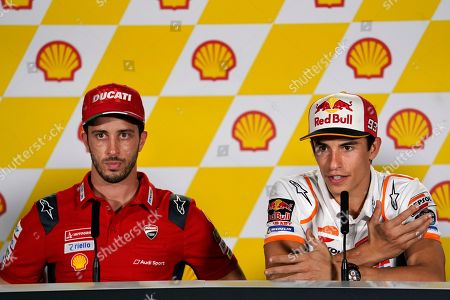 Marc Marquez, Andrea Dovizioso. MotoGP rider Marc Marquez of Spain, right, speaks next to Italy's rider Andrea Dovizioso of the Ducati Team looks on during a press conference at Sepang International Circuit ahead of the MotoGP Malaysian Grand Prix in Sepang