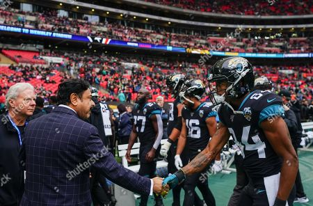 Stock Photo of Shahid Khan, owner of the Jacksonville Jaguars, shakes hands with Jacksonville Jaguars wide receiver Keelan Cole  (84) before kick-off.