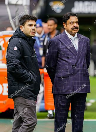 Stock Picture of Shahid Khan, owner of the Jacksonville Jaguars, with his son Tony Khan look on from the sideline.