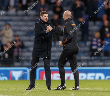 Rangers Manager Steven Gerrard celebrates with Rangers Assistant Manager Gary McAllister after the final whistle. Final score Rangers 3 Heart of Midlothian 0.