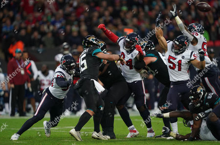 Stock Photo of Jacksonville Jaguars quarterback Gardner Minshew  (15) sees his throw blocked by Houston Texans linebacker Dylan Cole  (51), and Houston Texans inside linebacker Benardrick McKinney  (55)