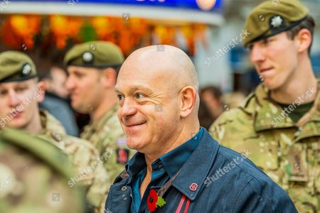 Stock Picture of Ross Kemp meets members of the Royal Anglians (who he filmed with in Afghanistan) as he Launches London Poppy Day 2019 on Liverpool Street Station, central concourse - 2000 service personnel join forces with veterans, volunteers and celebrities in an attempt to raise £1m in a single day for The Royal British Legion during London Poppy Day.