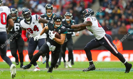 Jacksonville Jaguars tight end Seth DeValve  (88) takes the ball into the tackle from Houston Texans inside linebacker Zach Cunningham  (41)