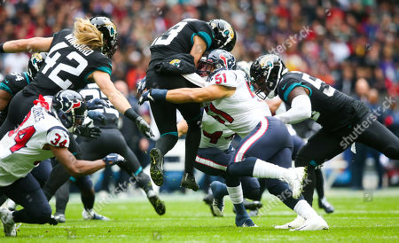 Stock Image of Massive hit from Houston Texans linebacker Dylan Cole  (51) on Jacksonville Jaguars wide receiver  Michael Walker (13) taking him off his feet