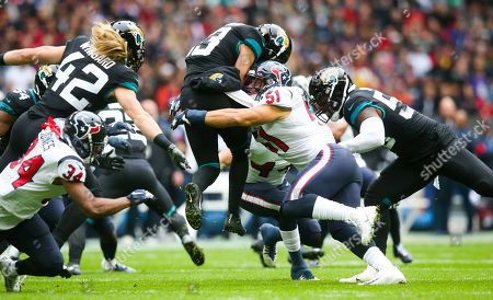 Massive hit from Houston Texans linebacker Dylan Cole  (51) on Jacksonville Jaguars wide receiver  Michael Walker (13) taking him off his feet
